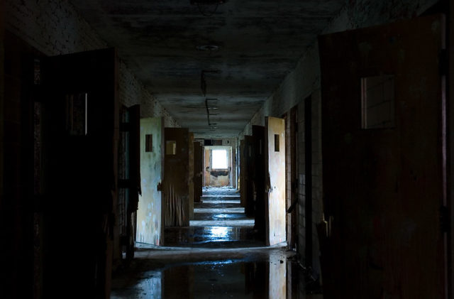 Darkened hallway with open doors