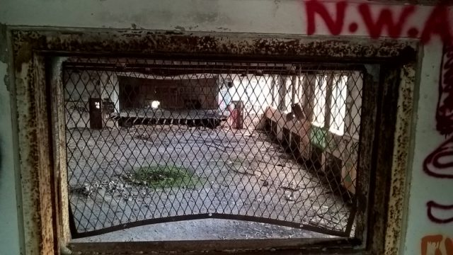 View of a room through a gated window