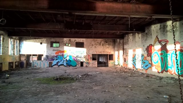 Graffiti-covered room at Burwash Correctional Center