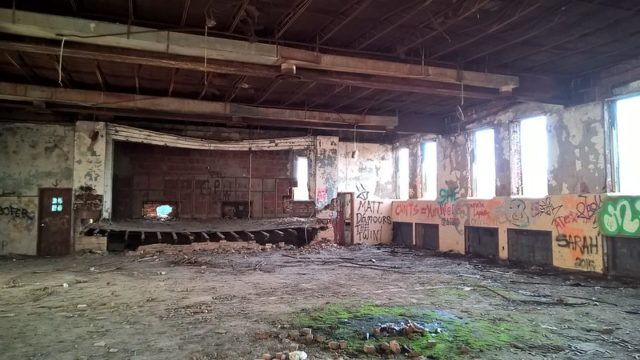 Dilapidated theater within the Burwash Correctional Center