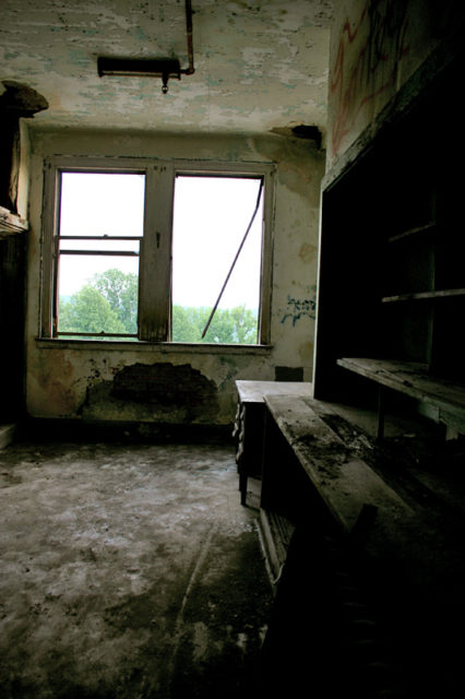 Empty desk in a decrepit room