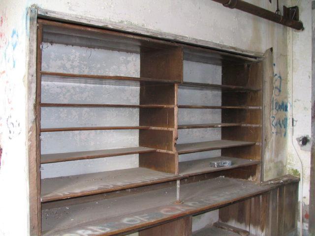 Empty linen shelf inside Waverly Hills Sanatorium