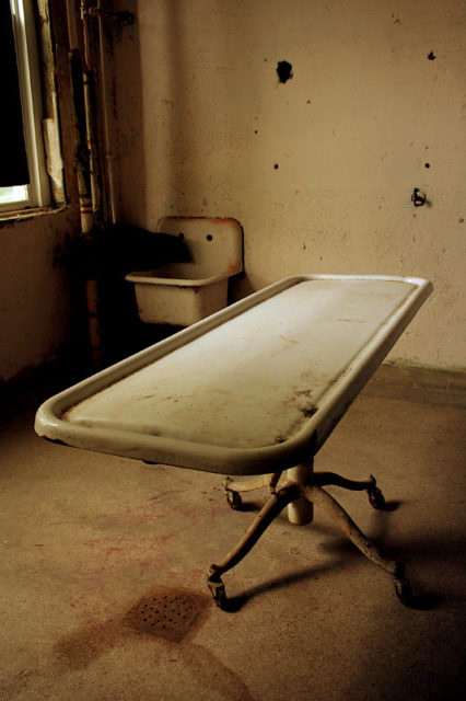 Observation table in the middle of a room at Waverly Hills Sanatorium