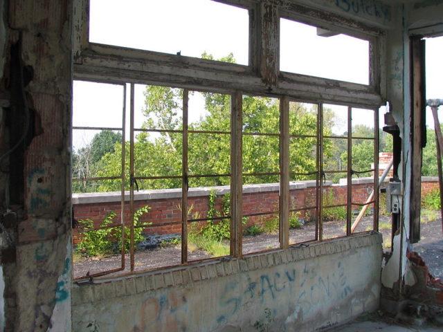 Looking outside through windows at the Waverly Hills Sanatorium